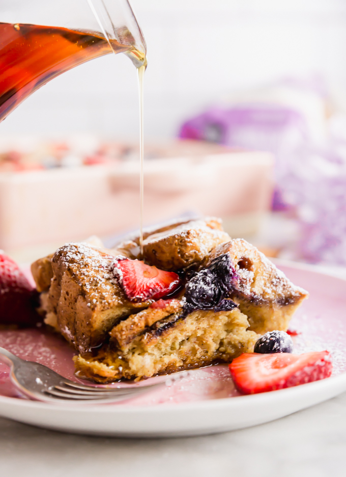 Pouring maple syrup over gluten-free french toast casserole