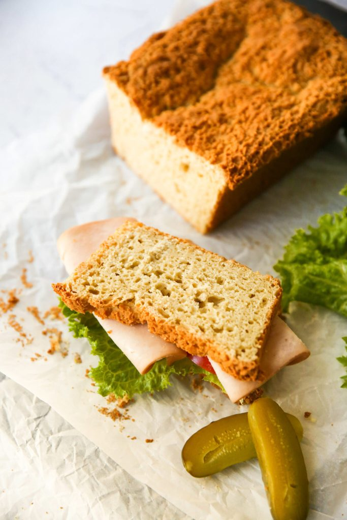 Picture of the gluten-free sandwich bread used for a turkey sandwich with a side of kosher pickle