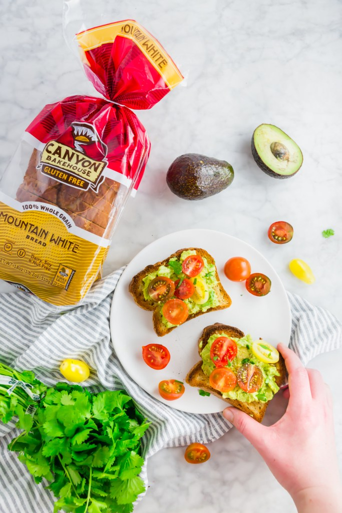 Picture of avocado toast and tomatoes on Canyon Bakehouse gluten-free bread