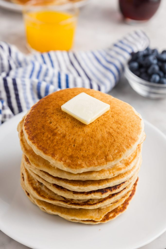 Final stack of pancakes served with a pat of butter