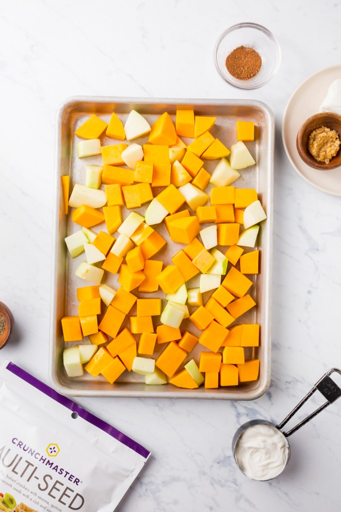 Picture of cubed squash and apples on roasted baking sheet