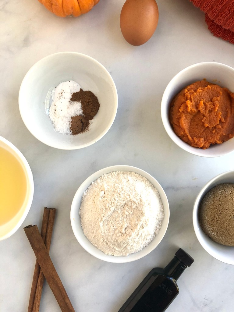 Picture of the cassava flour, melted butter, pumpkin puree and other ingredients needed for the cassava flour pumpkin cookies