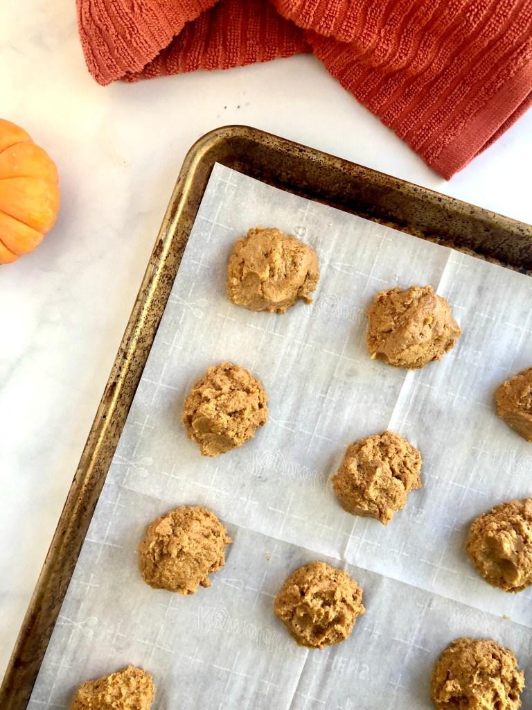Cookie dough mounds on a baking sheet