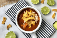 close up of the close up on the chicken enchilada soup in a bowl for header image