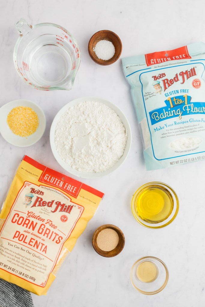 Picture of gluten-free pizza crust ingredients including Bob's Red Mill 1:1 flour and polenta