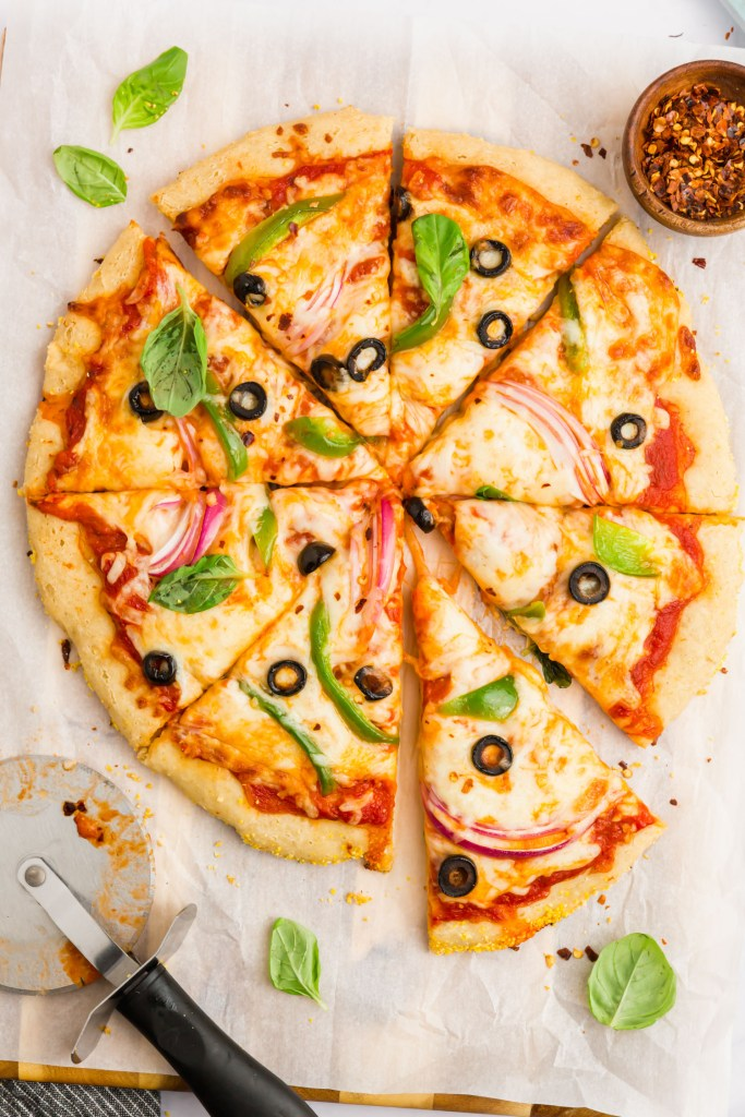 Gluten-free pizza crust from scratch with cheese and vegetable toppings