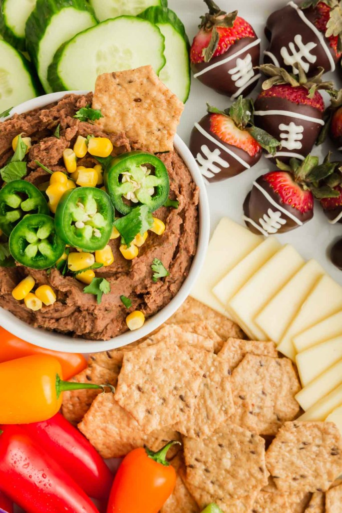 Snack board - up close on bean dip and chocolate footballs.