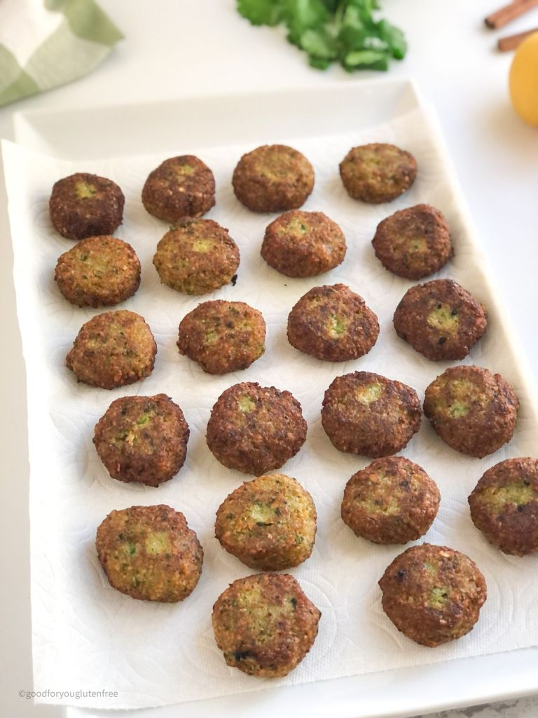 Picture of cooked gluten-free falafels on a paper towel-lined tray