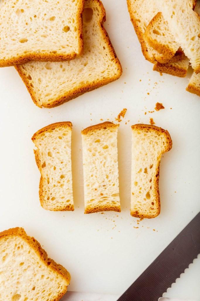bread cut into three strips to form sticks