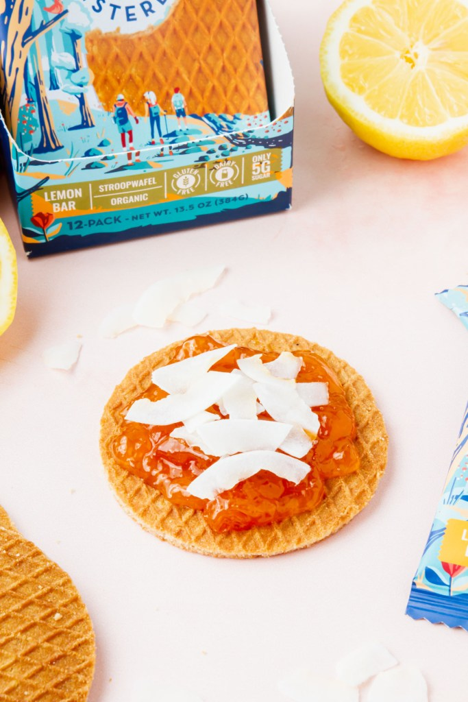 Sweet Amsterdam stroopwafel covered with jam and coconut flakes