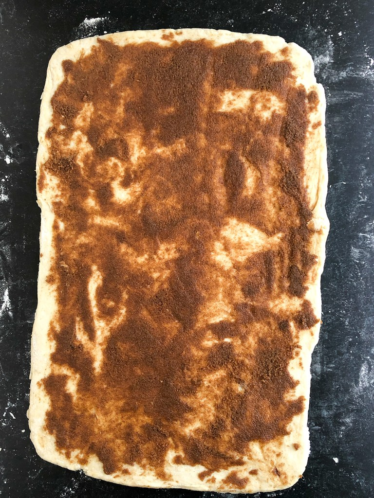 butter, brown sugar and cinnamon spread onto sweet dough