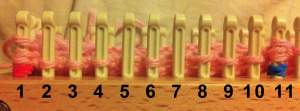 After step 14; 3 loops on pegs 1 and 11; pegs 5 and 7 are empty