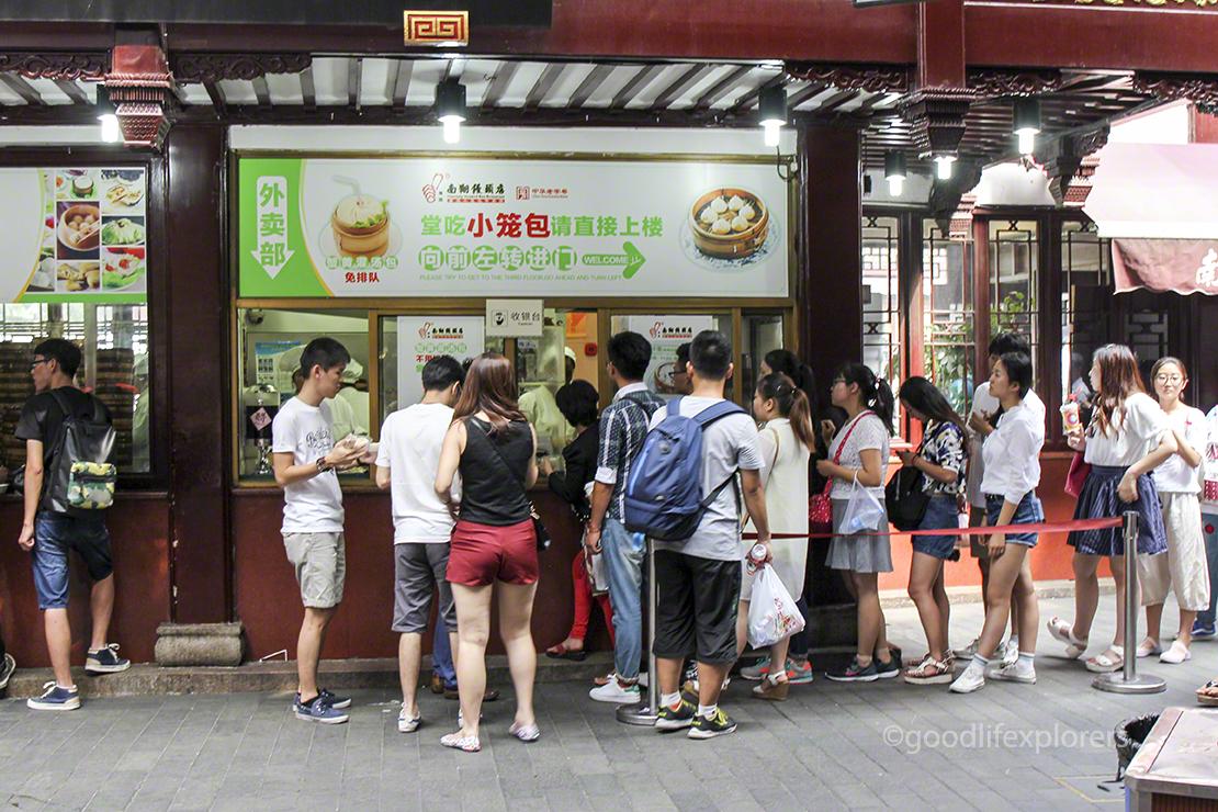 People waiting in line at Soup dumplings store in Shanghai