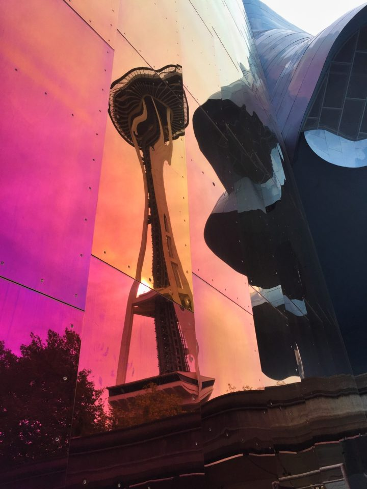 Space Needle reflected on building  in Seattle