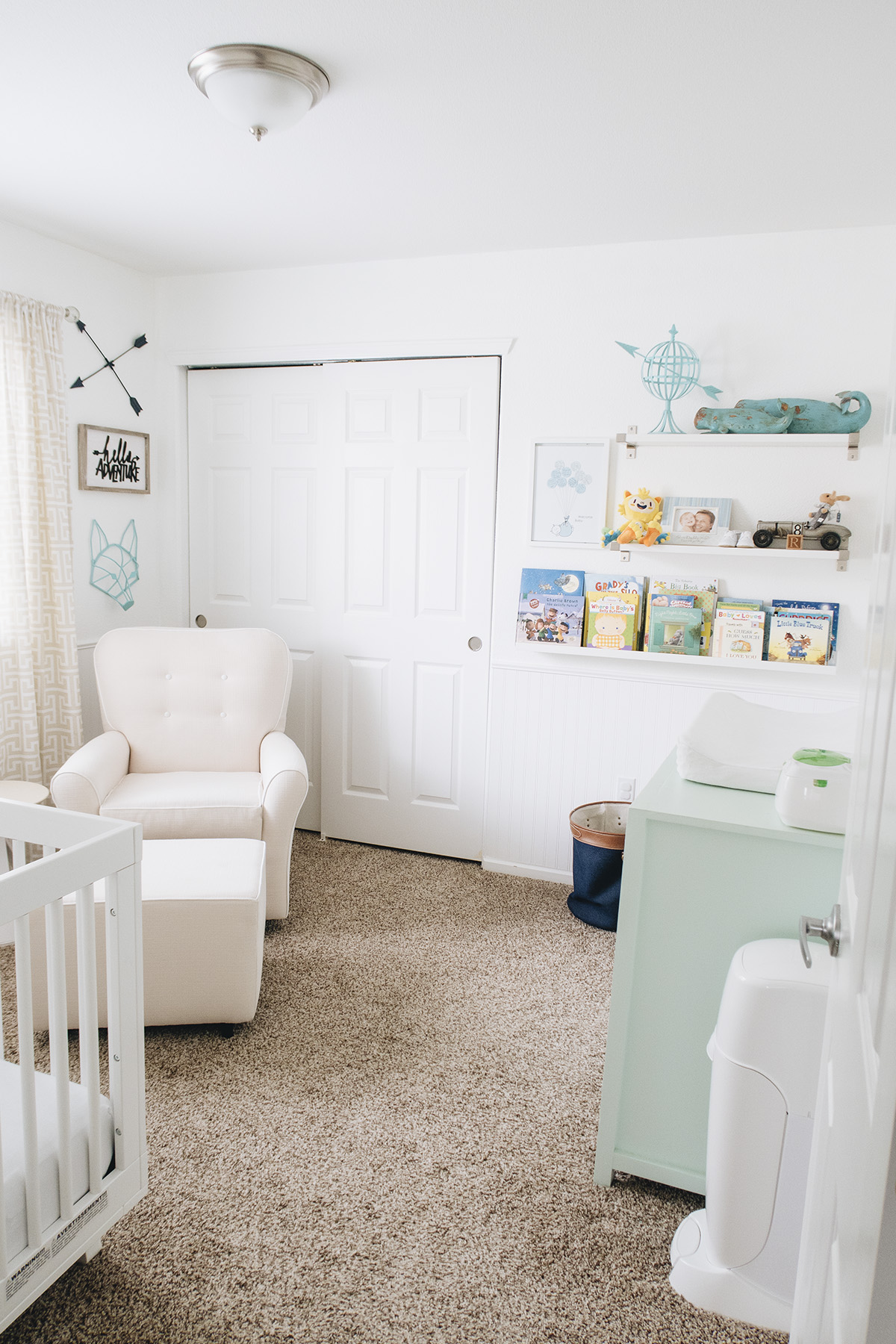 Nursery with white walls and pastel colors