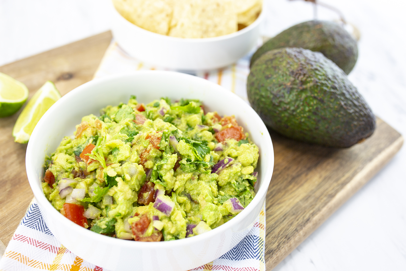Bowl of Guacamole served with tortilla chips