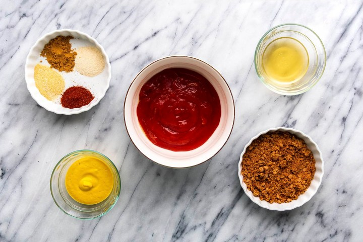 Ingredients to make homemade sour and sweet bbq sauce: spices, brown sugar, ketchup, mustard, apple cider vinegar