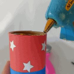 run a bead of glue around the top of the tube, glue gun and tube