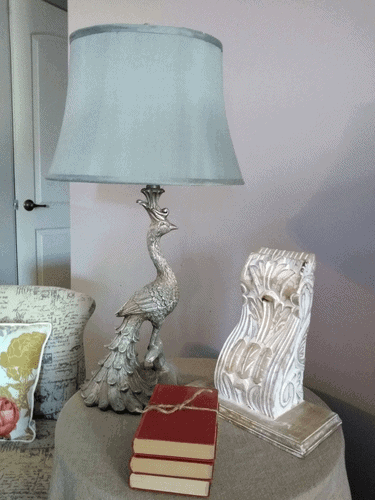 Peacock shaped lamp, architectural salvage and old books