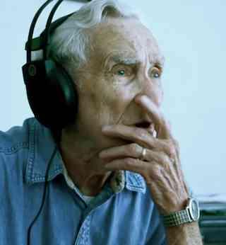 elderly man in headphones-GreenShoeStudioVid