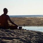 man-meditating-at-sea-CC-IcronticPrime
