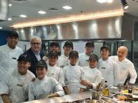 World renowned chef Alain Ducasse teaches Filipino street children how to cook