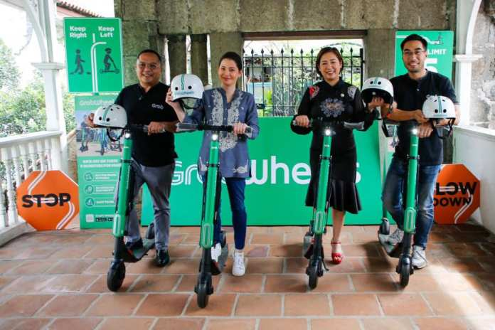 Travelers explore Intramuros on eScooters