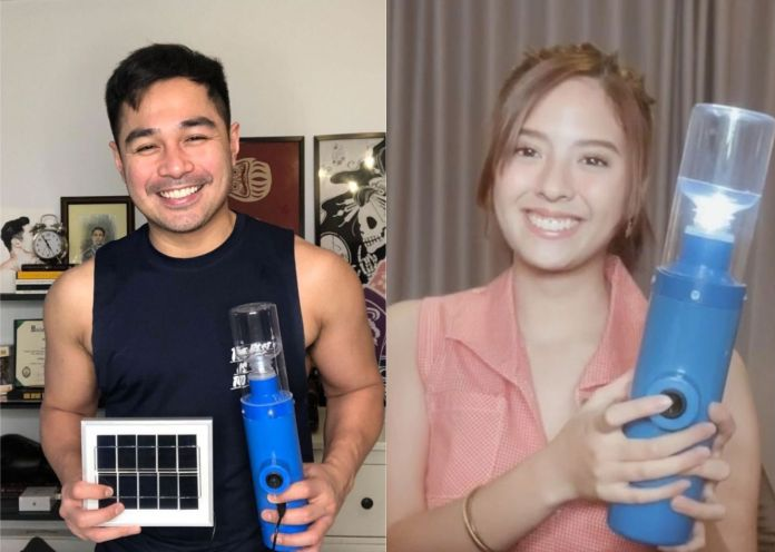 Benjamin and Ysabel with solar lamps