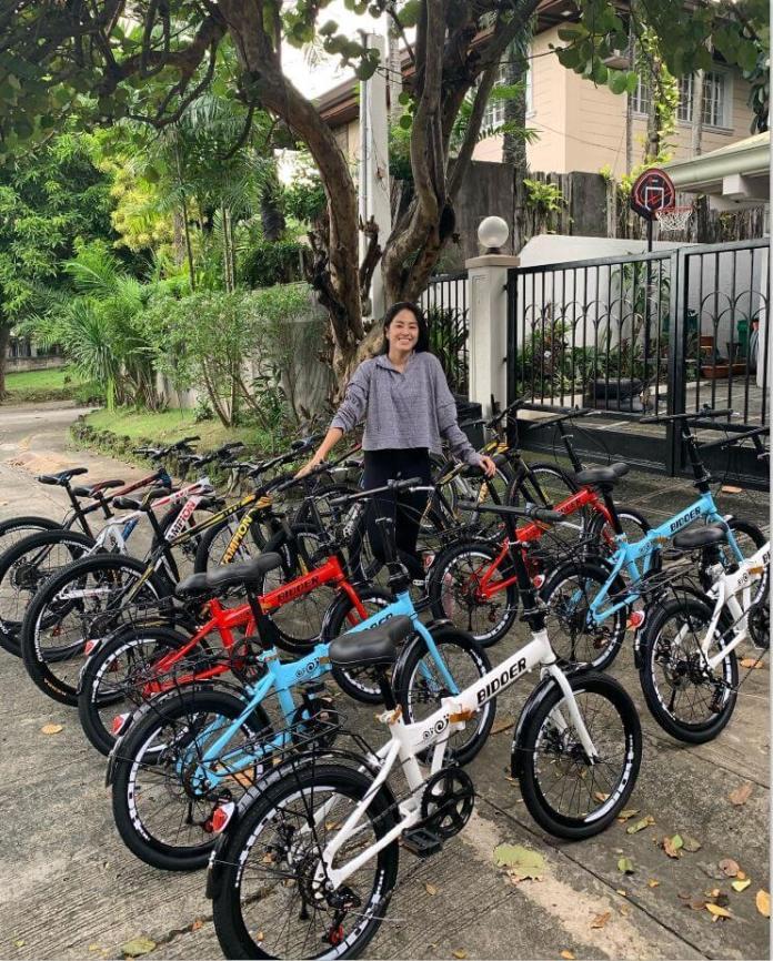 Gretchen Ho giving away bikes