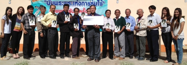 Thai Pastors with copies of By This Name