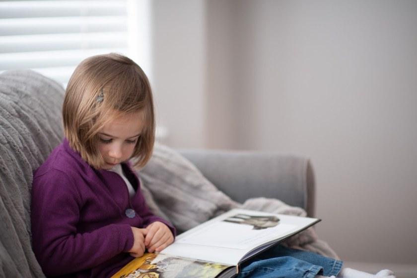 Little girl reading The Lamb
