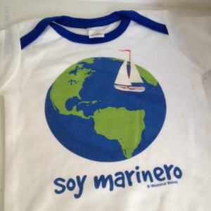 Baby bodysuit with sailboat and globe
