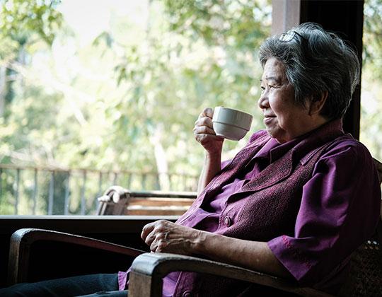 Good Shepherd Woman Holding Tea - Good Shepherd Fairview Home