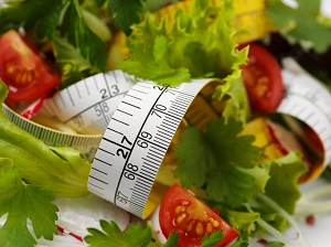lettuce and tomatoes with tape measure