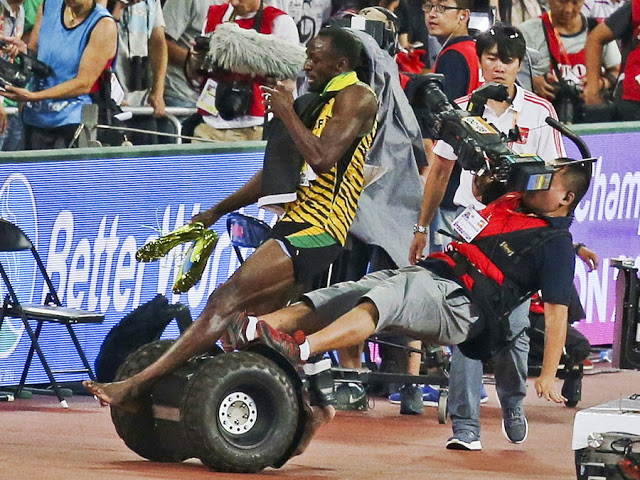 Usain Bolt Creates Record in Final; Gets knocked over by Segway