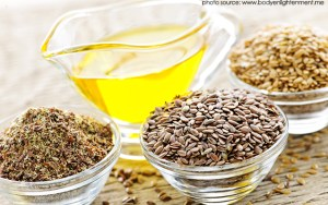 flaxseed oil benefits - flaxseed oil and cups of flaxseed