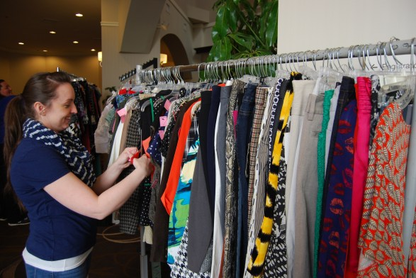 Tara Myers, Bridgeville store manager helping set up the boutique