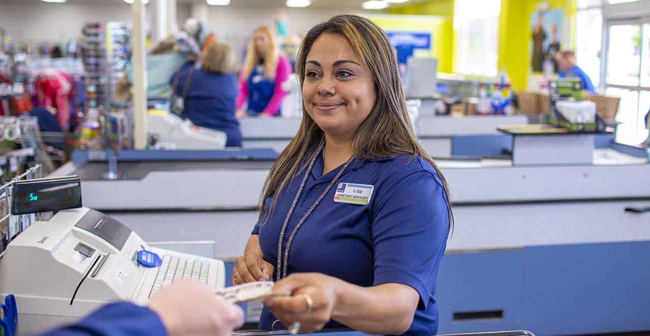 Goodwill cashier receiving voucher from customer
