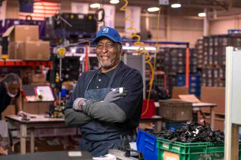 Senior African-American man on the production line.