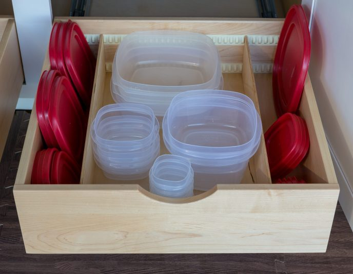 Easily organize your tupperware with our glide-out drawers!