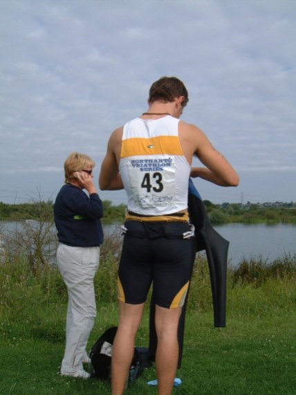 Lawrence Fanous, just about to put his wetsuit on