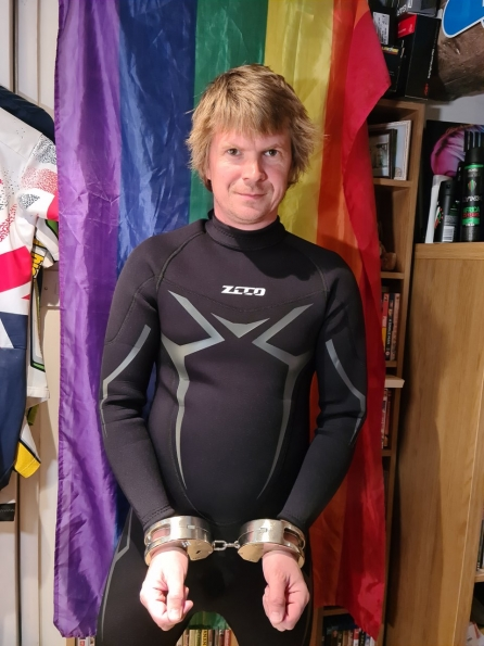 ZCCO wetsuit + Clejuso handcuffs