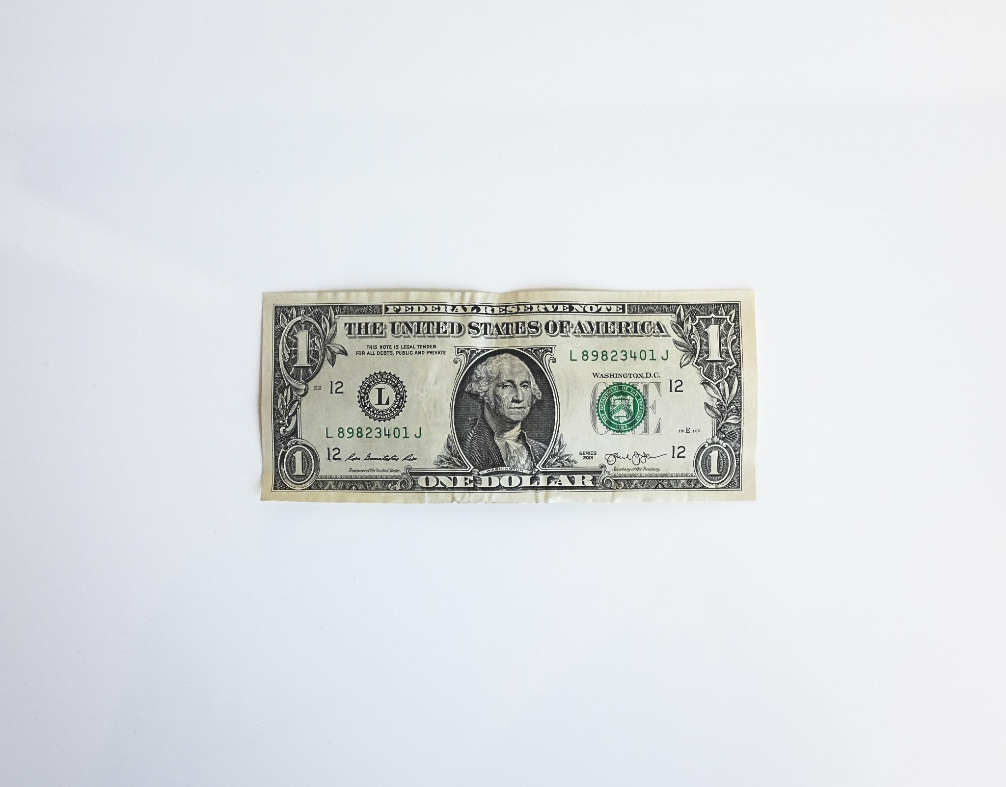 Dollar bill against white background