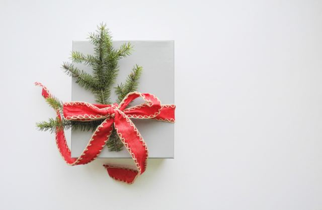 giving package with green spruce