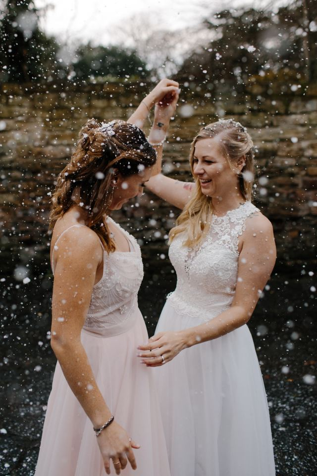 Two brides in white wedding dresses