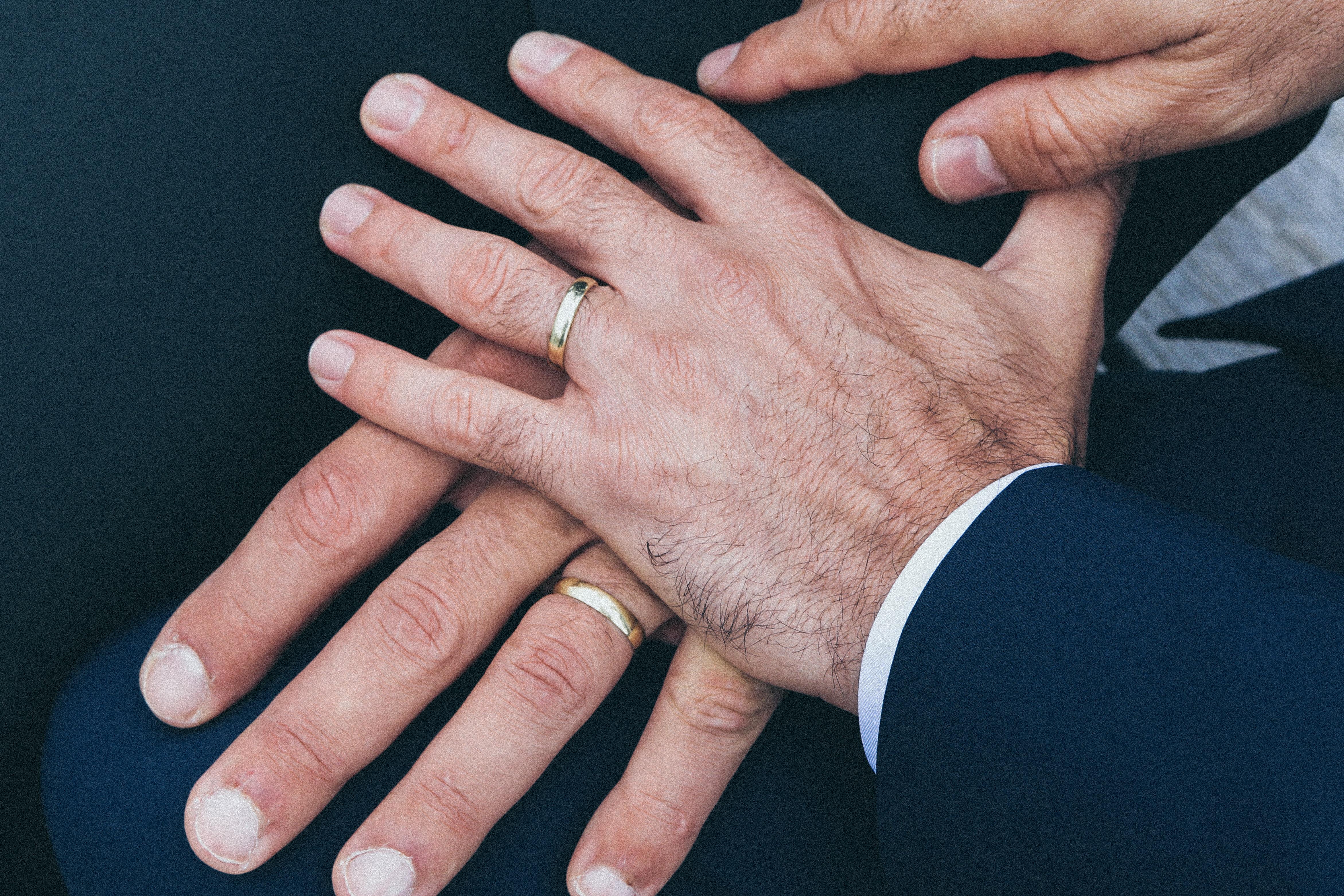 hands of 2 grooms