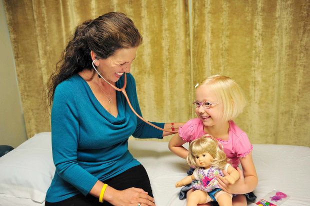 Michelle with pediatrics patient