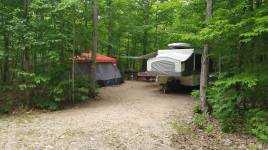 Campsite with a pop up tent trailer at Gordon's Park on Manitoulin Island