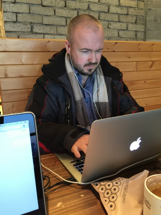 "That's me playing ""The Job Application Form Crashed My MacBook Again Blues"" at a café in the area. But not the good café I mention later. This was kind of a crappy, unheated café with mediocre coffee."