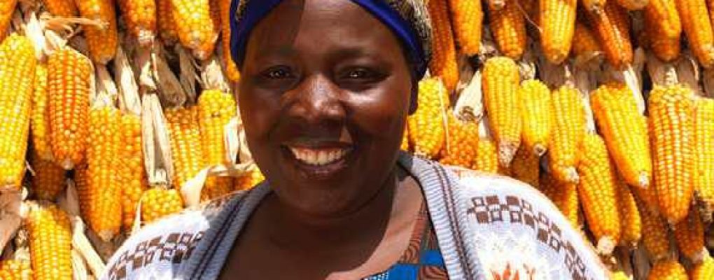 Lady selling corn at market, Rwanda